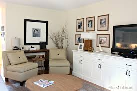 living room layout with 2 chairs family photo gallery above tv