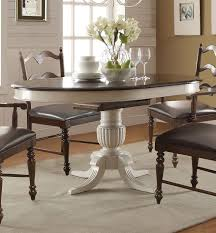 cambridge round oval pedestal dining table in molasses white