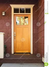 light wood front door on a home royalty free stock images image