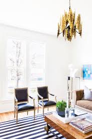 simple livingroom how to make your living room look luxe for less mydomaine