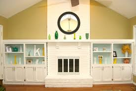 decor double side table and shelves with yellow painted wall for