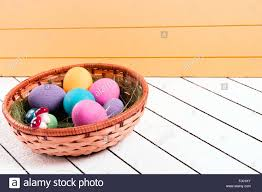 eco easter eggs colorful easter eggs in basket on a wooden background eco