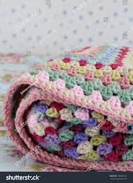 folded crochet afghan blanket shabby chic stock photo 182665154