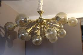 sputnik chandelier an iconic design for more than 50 years vintage gold semi sputnik ceiling light with murano glass for sale