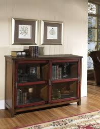 Bookcase With Sliding Glass Doors by Dark Brown Wooden Bookcase With Sliding Doors Plus Two Shelves And