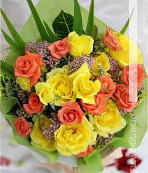 Peach Roses Dozen Yellow And 1 Dozen Peach Roses Round Bouquet