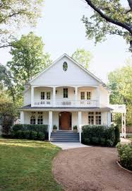 via farmhouse chic blog beautiful old white home with balcony