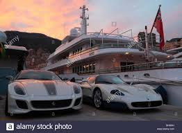 maserati ferrari maserati and ferrari in front of the motoryacht