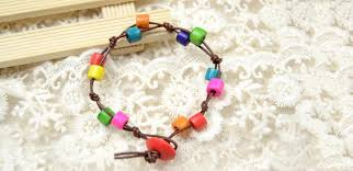 make rainbow bracelet images Tutorial on making rainbow wooden bead bracelet with simple knots jpg