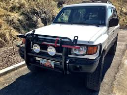 lifted mitsubishi montero hi lift mount