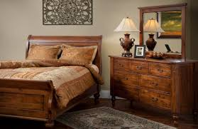 bedroom with wrought iron wall decor and solid oak furniture