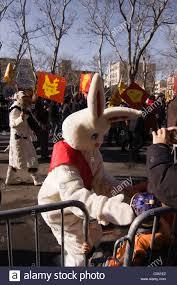 new year sash white rabbit with sash greeting children in new york city s