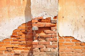 red clay stained on the white exposed brick concrete wall with