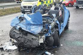 m58 crash police release shock photos after car and lorry crash