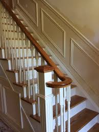 stair railings with black wrought iron balusters and oak boxed