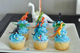 dinosaur cupcakes this modern dinosaur birthday party isn t a to pull