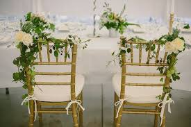 and groom chairs groom and flower embellished chairs for wedding reception