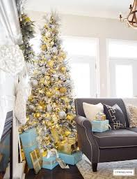 silver and gold tree transitional living room