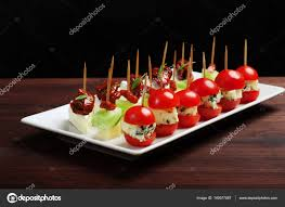 shoing canapé canape mini sandwiches with cheese blue cheese sun dried