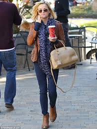 womens denim boots uk reese witherspoon dons a stylish pair of cowboy ankle boots and a