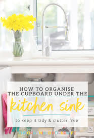 how to organise under the kitchen sink cupboard the organised