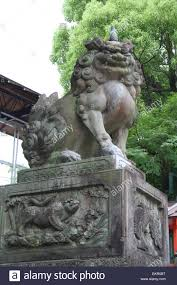 japanese guard dog statues japanese lion dog sculpture outside a temple in kyoto japan stock