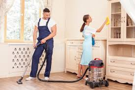 clean the house cheerful young workers are cleaning the house with stock image
