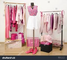 dressing closet pink clothes arranged on stock photo 190051307