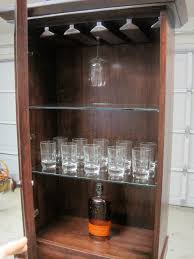 25 Unique Glass Paint Ideas by Furniture Dark Brown Wooden Bar Cabinet With Double Doors On