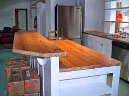 kitchen island table with varnished wooden butcher block top and white stained wooden kitchen counter bar and island with reclaimed table top combined galley cabinet as