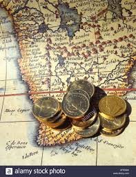 Map Of South Africa by Gold Kruger Rand Coins Lying On An Old Map Of South Africa South