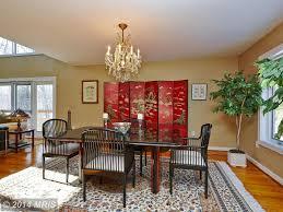 asian dining room with hardwood floors u0026 chandelier in vienna va