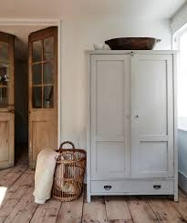wooden armoire cabinet wicker basket wooden french doors