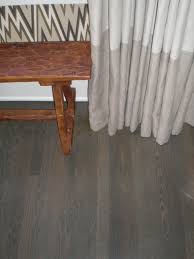 Laminate Wood Floor Reviews Elegant Laminate Grey Wood Floors With White Wooden Pillars As
