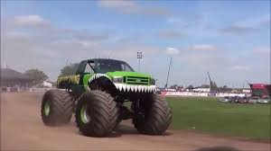 monsters truck videos swamp thing monster truck vs slingshot monster truck youtube