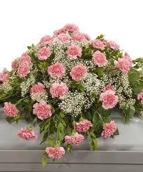 traditional carnation casket spray available in a variety of