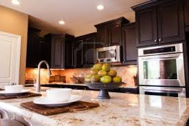 White Kitchen Cabinets With Black Countertops Wood Floor Our Wood Flooring Options Wood Flooring