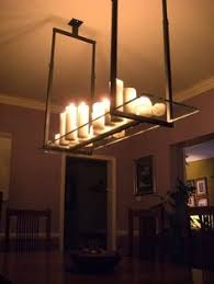 really liking these pillar candle chandeliers home sweet home