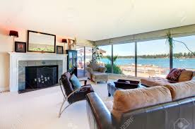 Large Living Room Furniture Living Room With Fireplace Modern Furniture And Water View With