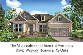 single level homes introduce encore by david weekley homes new model open at 12