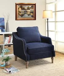 furniture blue upholstered chair with back rest and nails accent