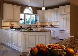 white kitchen cabinets with cathedral doors is the cathedral cabinet look popular