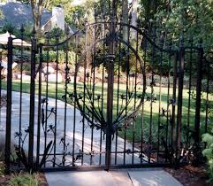 hand forged garden gate with sweet pea vines and iris flower