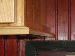 how to trim the bottom of a cabinet installing molding for cabinet lighting concord