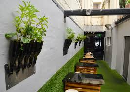Indoor Vertical Gardens - sophisticated brown accent modern sofas and ottoman added beauty