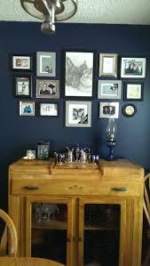 gallary photo arrangement on dark blue wall starless night by