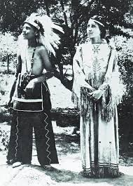 a cherokee boy and in traditional dress on a north carolina