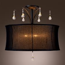 Chandelier With Black Shade And Crystal Drops Black Fabric Drum Shade Pairs With Clear Crystal Drops Add Mystery