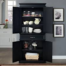 black kitchen storage cabinet crosley parsons black storage cabinet cf3100 bk the home depot