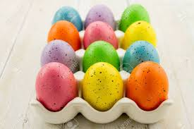 ceramic easter eggs brightly colored speckled easter eggs sitting in ceramic egg